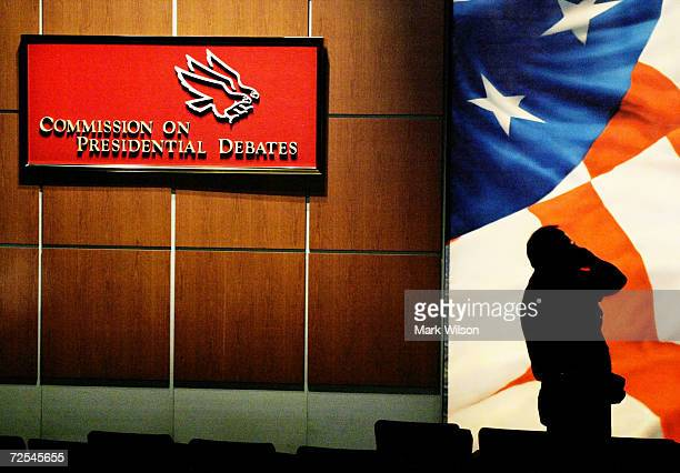 Worker is silhouetted during a sound check near the stage where President George W. Bush and Democratic presidential candidate Sen. John Kerry will...
