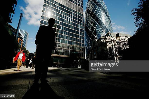 A worker is silhouetted in the forecourt of 30 St Mary's Axe nicknamed The Gherkin on September 18 2006 in London England The famous London landmark...