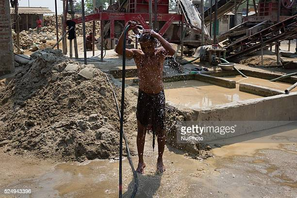 A worker is taking shower during a break in a Stone Crashing Plant in Sylhet Bangladesh A huge percentage of stone is being supplied to all over the...