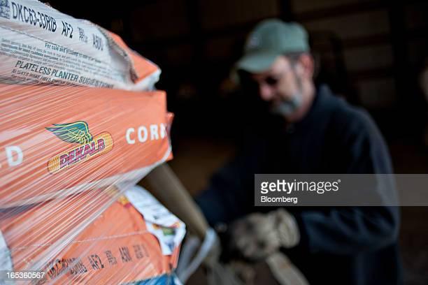 Worker Jim Delbridge unstraps a delivery of Monsanto Co DeKalb brand seed corn on a farm in Princeton Illinois US on Wednesday April 3 2013 Monsanto...
