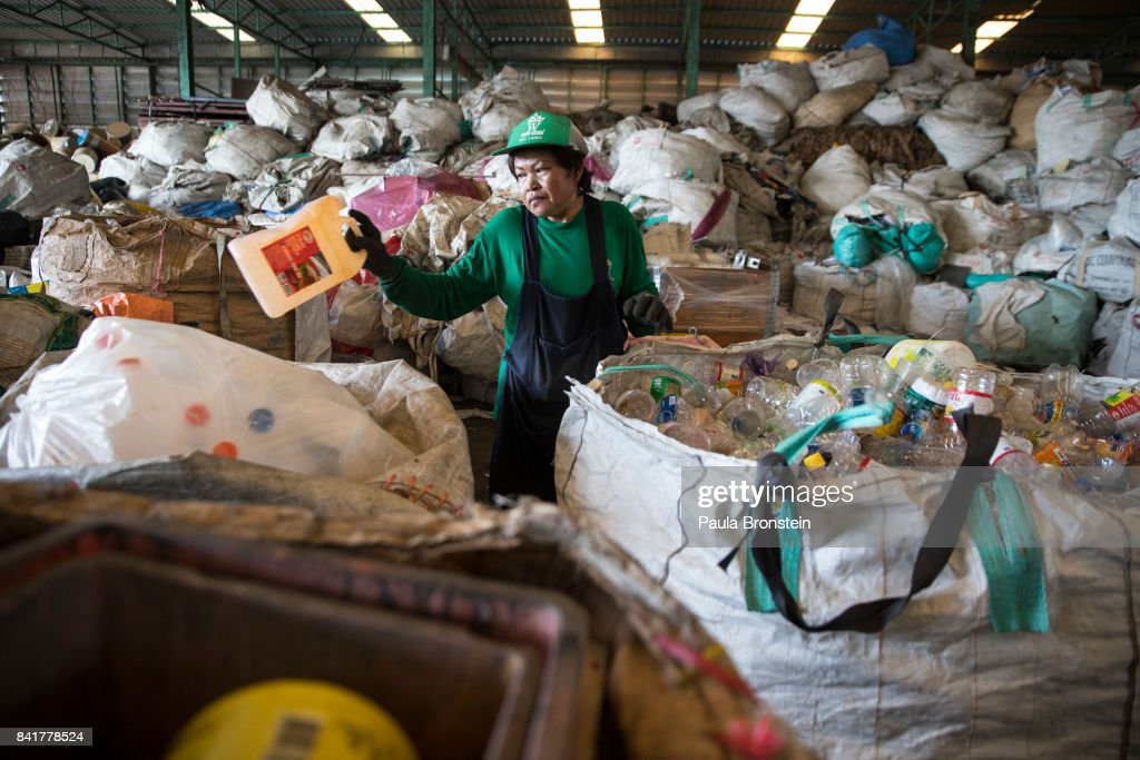 Worker Kamol Srilaloong manually separates plastic bottles at the Wongpanit Suvarnabhumi recycle collection center on September 1, 2017 in Bangkok, Thailand. People arrive at the recycling and sorting center with their products, plastic, metal, steel and paper. They are paid by weight according to the market cost. Plastic bottles can be recycled into Polyethylene Terephthalate (PET) bottle flakes and post consumer recycle (PCR) for the textile market IPI -NPT chips. Many plastic items like shopping bags, and food wrapping tend to be used for short periods before being discarded. A recent study stated that Thailand along with China, Indonesia, the Philippines and Vietnam are on the list of the world's top-five plastic polluters. Cleaning up plastic pollution in Thailand is a challenge due to cultural, infrastructure and environmental obstacles.