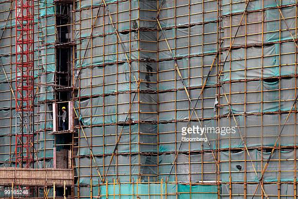 A worker labors on a construction site for a residential development in Shanghai China on Thursday May 13 2010 Shanghai's municipal government may...