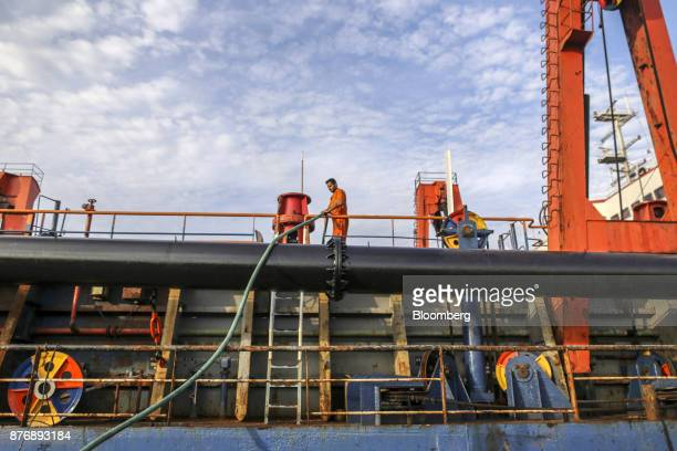 A worker labors on the Navayuga 2 dredger while docked at Krishnapatnam Port in Krishnapatnam Andhra Pradesh India on Saturday Aug 12 2017 Growth in...