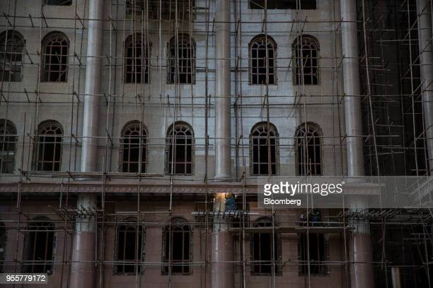 A worker labors on the scaffolding of a building under construction in Dushanbe Tajikistan on Saturday April 21 2018 Flung into independence after...