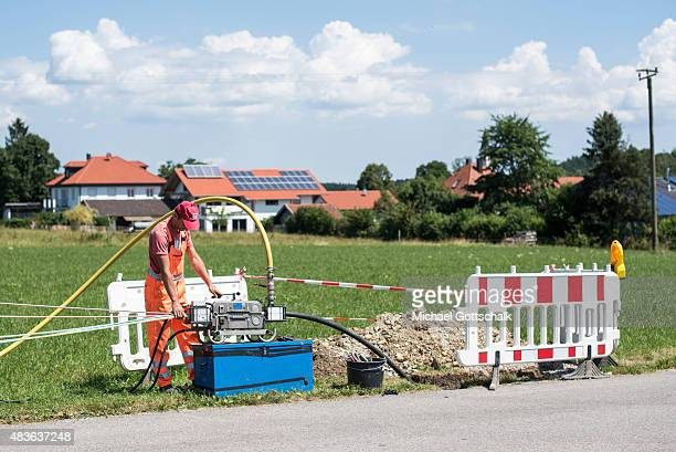 A worker laid a fiber optic cable in bavaria on July 21 2015 in Deggendorf Germany
