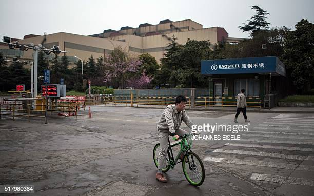 A worker leaves the Baosteel Group Corporation plant in Shanghai on March 29 2016 / AFP / JOHANNES EISELE