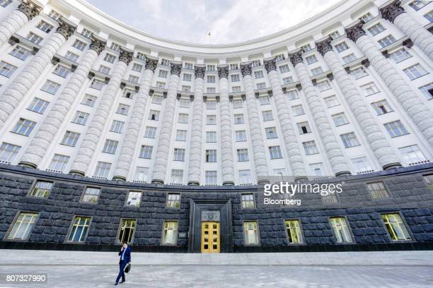 A worker leaves the the cabinet of ministers building in Kiev Ukraine on Monday July 3 2017 The next transfer of Ukraines $175 billion international...