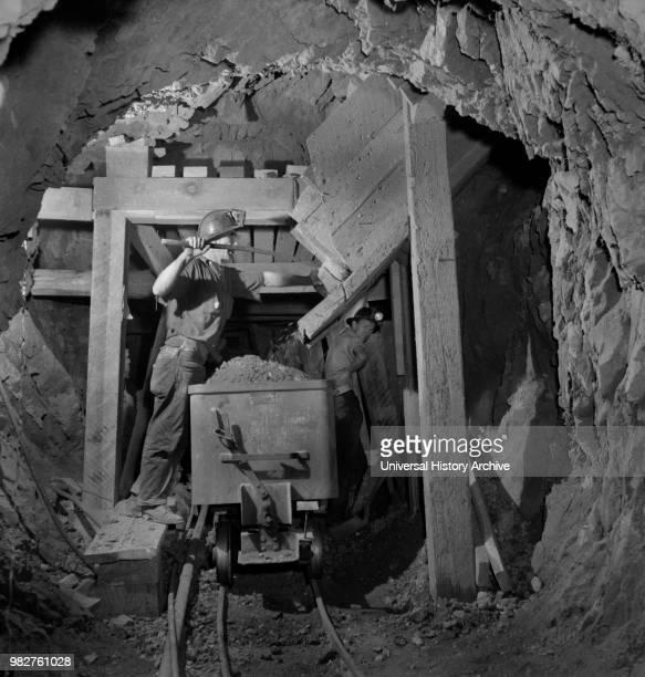 Worker Loading Mercury Ore from Chute into Mine Car Quicksilver Mining Company New Idria California USA Andreas Feininger for Office of War...