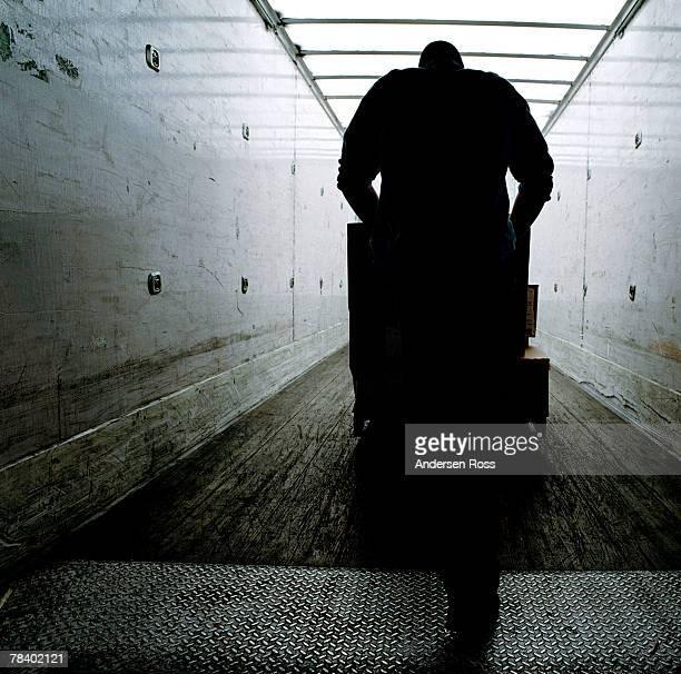 Worker loading truck