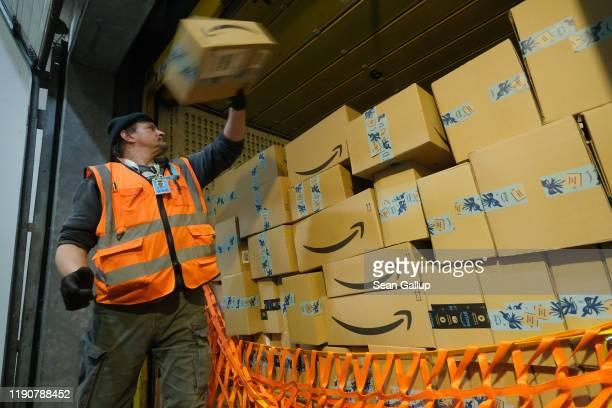 Worker loads a truck with packages at an Amazon packaging center on November 28, 2019 in Brieselang, Germany. Amazon is anticipating a strong holiday...