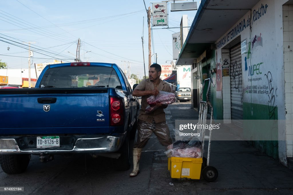 A worker loads pork into a truck for delivery at the Obrador Muoz meat wholesale and distribution center in San Luis Potosi, Mexico, on Friday, June 8, 2018. Mexico will begin to tax a range of U.S. products, including pork, in retaliation for tariffs on Mexican steel and aluminum that PresidentDonald Trump announced last week. Mexico is the largest market for U.S.porkexports, accounting for around 25% of last year's shipments, according to the NationalPorkProducers Council. Photographer: Mauricio Palos/Bloomberg via Getty Images