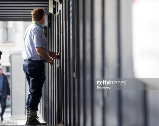 A worker locks a service gate on the Arundel Great Court development operated by Carillion Plc in London UK on Monday Jan 15 2018 Carillion a UK...