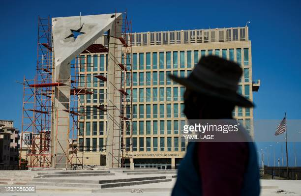 Worker looks at a huge concrete Cuban flag being build in front of the U.S. Embassy in Havana, on April 1, 2021.