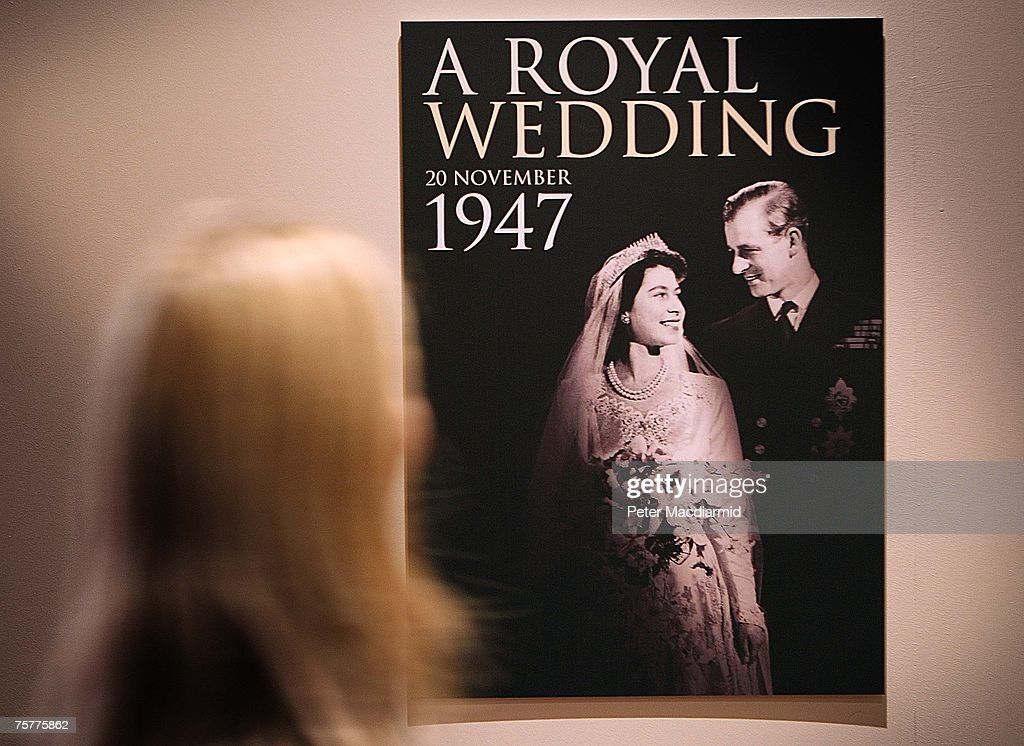 A worker looks at a poster of the 'Royal Wedding: 20 Novermber 1957 exhibition' at Buckingham Palace on July 27, 2007 in London. Queen Elizabeth II will be the first reigning sovereign to celebrate a 60th wedding anniversary. This new exhibition will mark the occasion by recreating the day in 1947 when Princess Elizabeth married The Duke of Edinburgh at Westminster Abbey. The collection of archive film footage, behind the scenes preparations, dresses, jewels and gifts reflect the mood of public rejoicing that swept the nation in the immediate aftermath of World War II.
