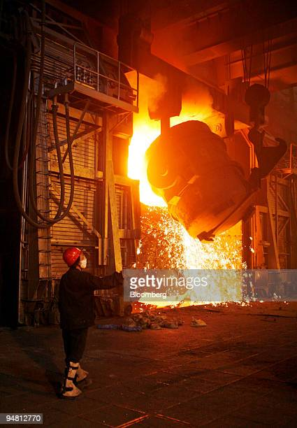 A worker looks at a steel smelter at Maanshan Iron Steel factory in Maanshan Anhui Province China Monday April 10 2006 Maanshan Iron Steel Co China's...