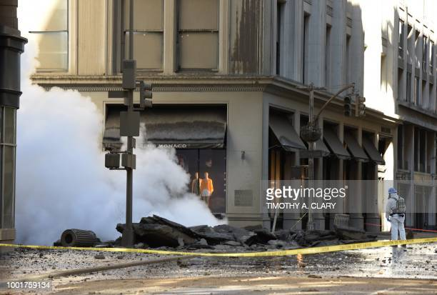 A worker looks at steam coming from 5th Avenue after a steam explosion tore apart the street in the Flatiron District of New York on July 19 2018...