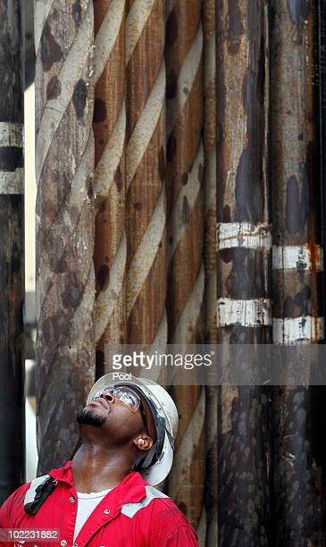 A worker looks at the casing pipe on the Development Driller II which is drilling a relief well at the site of the Deepwater Horizon oil spill on...