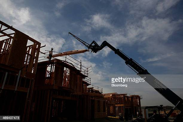 A worker looks on as section of a new home is lifted into place at the Toll Brothers Inc Baker Ranch community development in Lake Forest California...