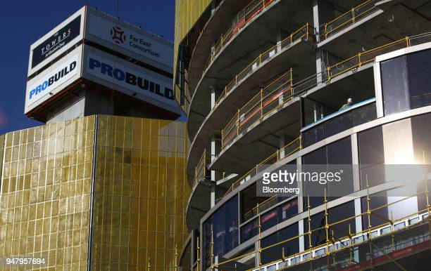 A worker looks out from a construction site in the Elizabeth Quay area of Perth Australia on Wednesday April 11 2018 Australia is scheduled to...