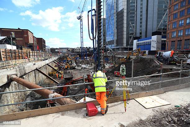 Worker looks over the foundations of the construction site of Principal Place, a joint development by Brookfield Property Partners LP, Concord...
