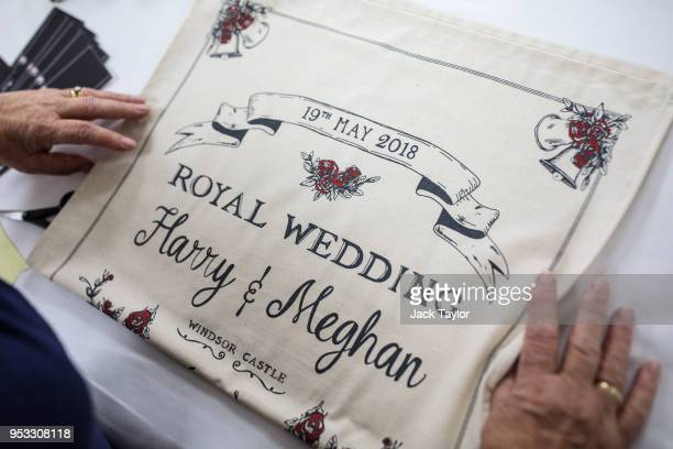 Worker Lynne Needham folds and packages commemorative tea towels by Victoria Eggs to mark the wedding of Prince Harry to Meghan Markle at Countryside...