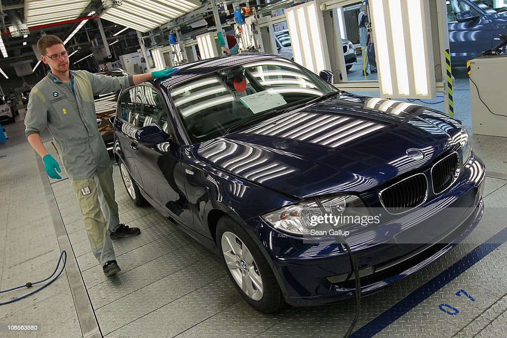 A Worker Makes A Final Visual Inspection Of A Completed BMW Car At The BMW  Auto