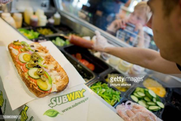 Worker makes a sandwich inside the fast food chain Subway in Hannover, Germany, 21 August 2015. The sandwich fast food chain will celebrate its 50th...