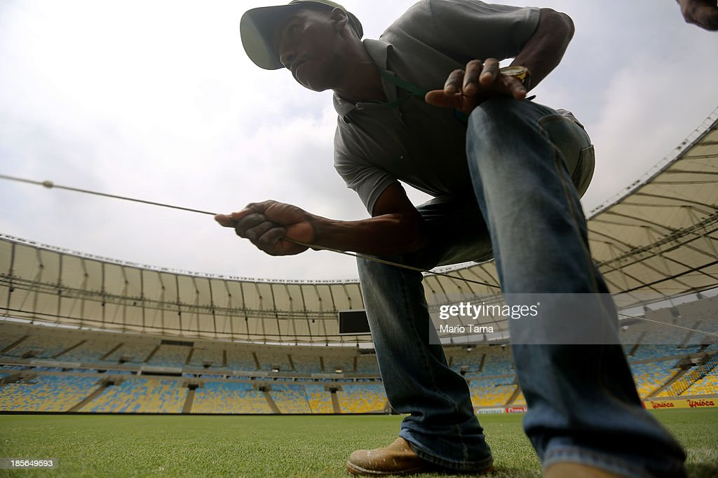 A worker makes an adjustment at Maracana Stadium during the 1st World Press Briefing for the Rio 2016 Olympic Games on October 23, 2013 in Rio de Janeiro, Brazil. Preparations for the Rio 2016 Olympic Games are continuing and the venue will host the Opening Ceremony, Closing Ceremony and football finals during the Games.