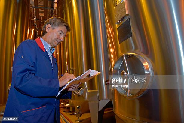 Worker makes an inspection in the blending vats room at the Piper-Heidsieck champagne factory, owned by Remy-Cointreau, in Reims, France, on Monday,...