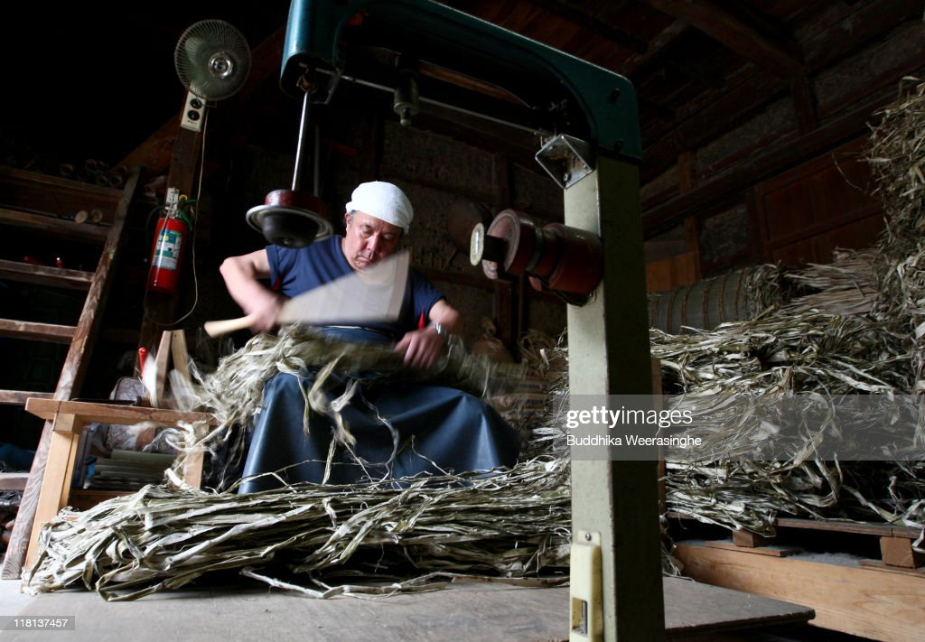 A worker makes bundles of mulberry wood at a mill that produces handmade paper at Iwano Heizaburo Seishi Sho Company in Echizen paper village on July 4, 2011 in Fukui, Japan. Washi paper is a tough paper, used for traditional Japanese arts such as Origami and Shodo, most commonly made from bark of the mulberry, gampi or mitsumata. The paper milling process is a traditional craft of the Echizen people dating back 1500 years which continues today along with modern paper manufacturing. Echizen city is home to many paper businesses, as well as the cultural museum of paper and papyrus centre where visitors can make their own paper.