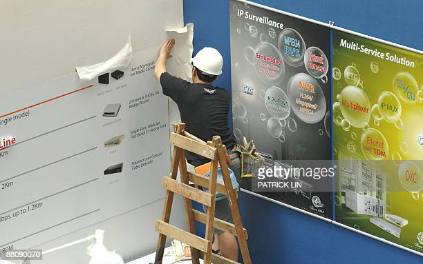 Worker makes his last preparations for Computex Taipei 2009 in the Taipei World Trade Centre on June 1, 2009. The information technology and...