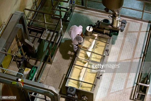 A worker makes pasta at an Alicorp SAA food processing plant in Machado Brazil on Wednesday May 14 2014 Brazil's unemployment rate in April was below...