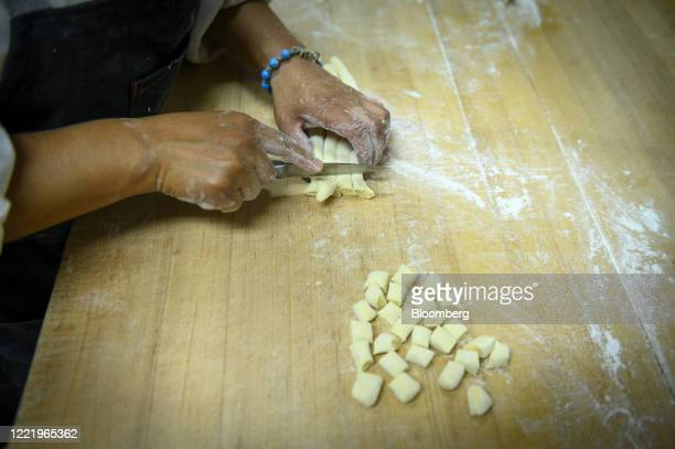 """Worker makes pasta at I Trulli restaurant in New York, U.S., on Friday, June 19, 2020. As part of so-called """"Phase Two,"""" New York Citys 27,000..."""