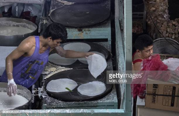 A worker makes spring roll wrappers at a market in Manila on January 23 2018 An estimated 10 million Filipinos work overseas and the money they send...