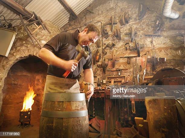 worker making barrel in cooperage - strike industrial action stock pictures, royalty-free photos & images