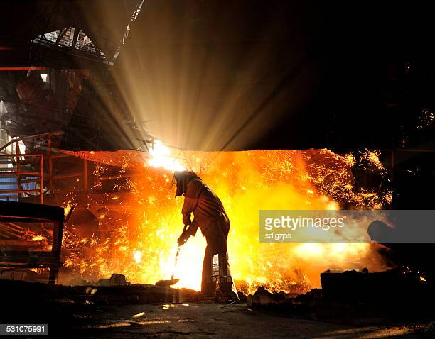 worker making iron water - steelmaking stock photos and pictures