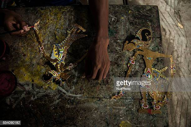A worker making shadow puppets in Wukirsari Imogiri Bantul Yogyakarta Indonesia on May 23 2016 Shadow puppets are made of buffalo skin an Indonesian...