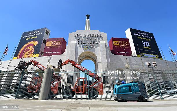 A worker manouevers is vehicle past an entrance to the Los Angeles Coliseum which played host to the 1932 and 1984 Summer Olympics in Los Angeles...