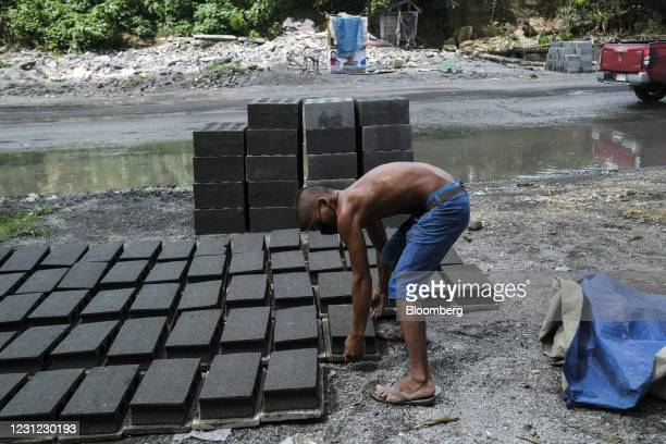 Worker manufactures handmade bricks along a highway on the outskirts of Cotabato City, Mindanao, the Philippines, on Wednesday, Feb. 17, 2021....