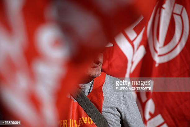 A worker marches during a demonstration organised by Italian General Confederation of Labour union on October 25 2014 in central Rome as part of a...