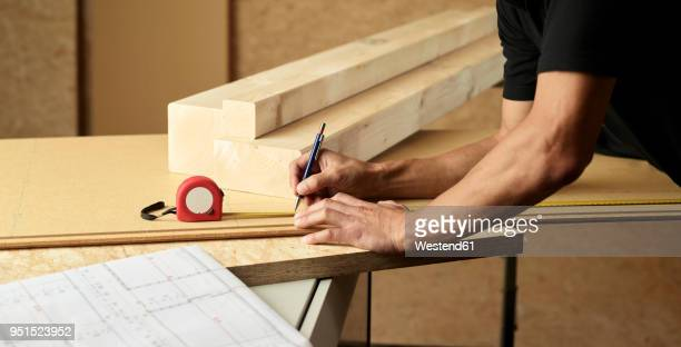 worker marking wood with pencil, tape measure - length stock pictures, royalty-free photos & images