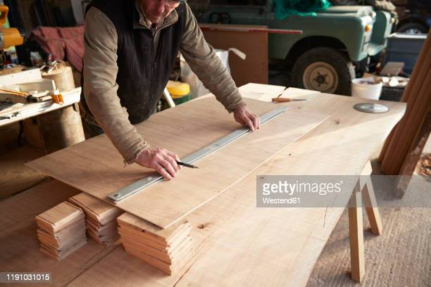 worker measuring wood - length stock pictures, royalty-free photos & images