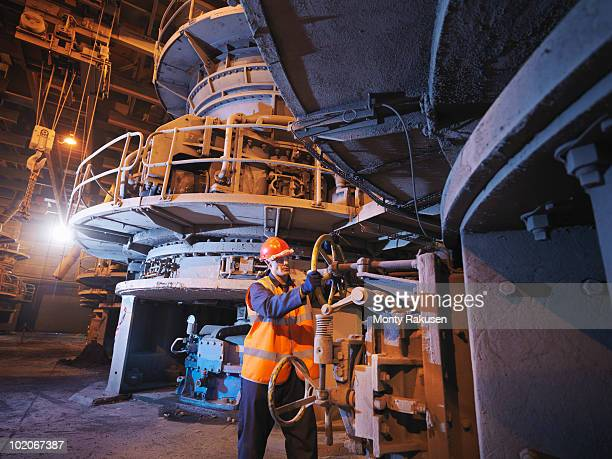worker milling coal in power station - monty rakusen stock pictures, royalty-free photos & images
