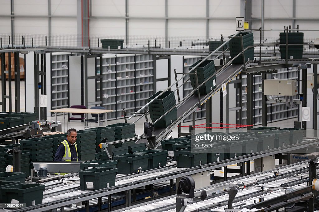 A worker minds items in the assembly line in the giant semi-automated distribution centre where the company's partners process the online orders for the John Lewis department store on January 3, 2013 in Milton Keynes, England. John Lewis has published their sales report for the five weeks prior December 29, 2012 which showed online sales had increased by 44.3 per cent over the same period in 2011. Purchases from their website Johnlewis.com now account for one quarter of all John Lewis business.