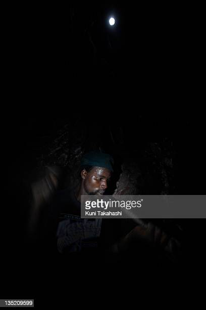A worker mines wolfram April 30 2010 in Ngungu 60km west of Goma Democratic Republic of Congo The long war which had involved 9 African nations and...