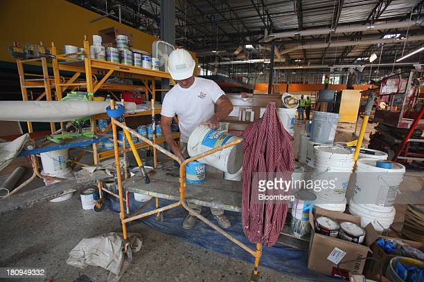 Worker mixes super spec inside a new Whole Foods Market Inc. Store under construction in Park Ridge, Illinois, U.S., on Tuesday, Sept. 17, 2013....