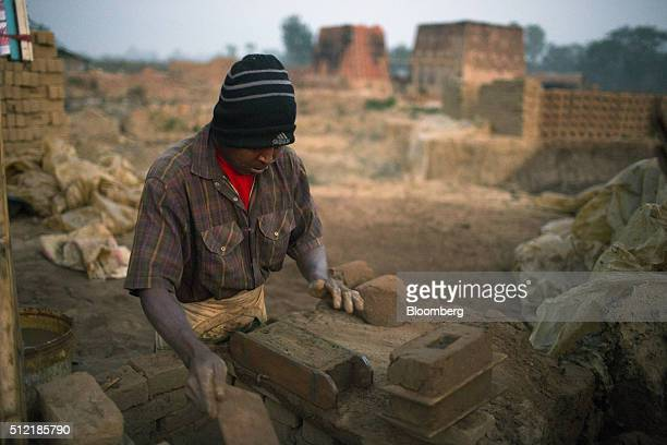 A worker molds clay into bricks at a brick manufacturing facility near Kengtung Shah State Myanmar on Friday Feb 19 2016 For all the democratic...
