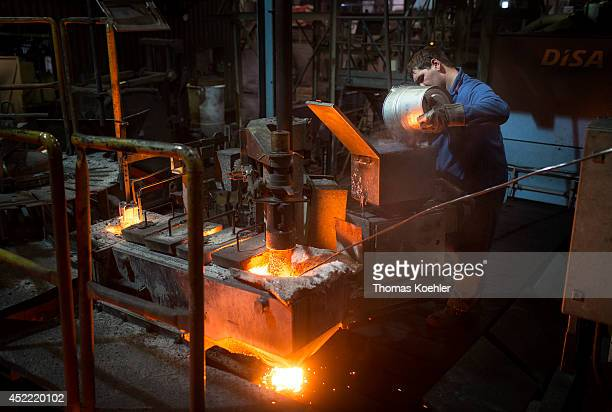 Worker monitoring a blast furnace of the Ortrander Eisenhuette GmbH an ironworks on July 03 in Ortrand Germany The ironworks manufactures with...
