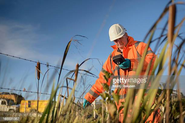 Worker monitoring water at surface coal mine