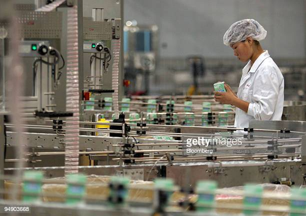 A worker monitors a milk production line at an Inner Mongolia Yili Industrial Group Co factory in Hohhot Inner Mongolia August 15 2005 Inner Mongolia...